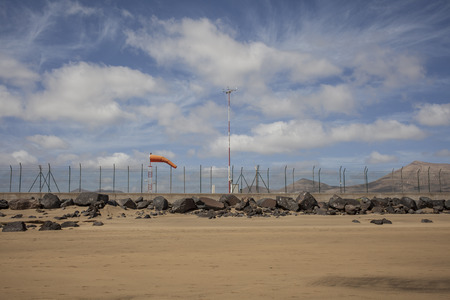 glass fence: Orange windsock at the airport of Lanzarote