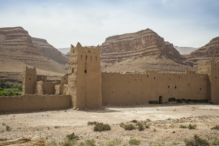 Clay fort in the desert in Morocco photo