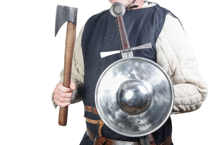 buckler: Man in medieval soldier clothing with shield and sword and axe Stock Photo