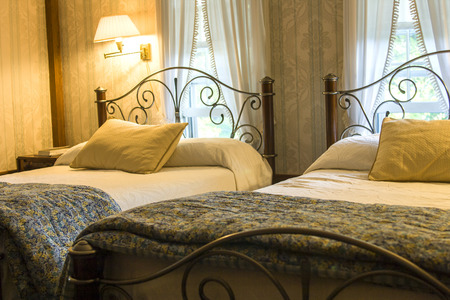 double beds: Classical warm bedroom with two beds