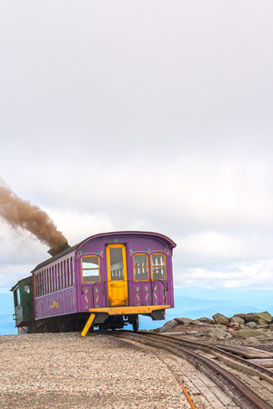 return trip: The cog train up Mount Washington is one of the steepest railways and the first (1869) mountain climbing railway in existence. It uses 1000 kilos of coals for the return trip to Mount Washington.