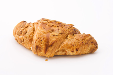 flaked: Fresh croissant with almonds on white