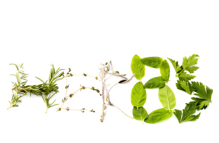 freshly picked: The word herbs made of different herbs. Rosemary, thyme, sage, basil and parsley