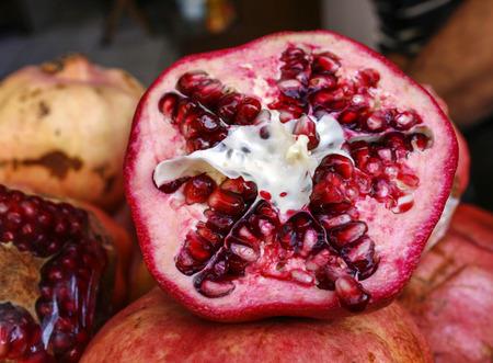 granada: Half open pommegrenate in close up