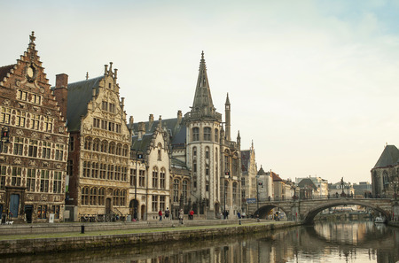 Picturesque medieval buildings overlooking the  Graslei harbor  on Leie river in Ghent town, Belgium, Europe  photo