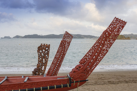 Traditional Maori wood carved canoes on the shore at Waitangi n New Zealand