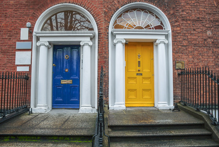 Two vintage Georgian doors in yellow and blue in Dublin