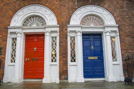 Typical red and blue Georgian doors  Dublin, Ireland photo