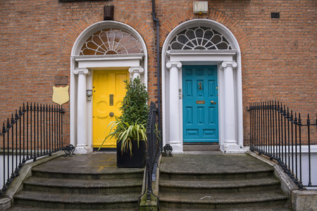 Vintage Georgian doors in yellow and turquoise in Dublin Stock Photo - 27267650
