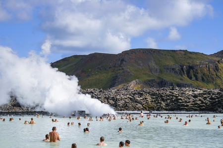 grindavik: GRINDAVIK, ICELAND - July 27   People enjoying the famous Blue Lagoon geothermal spa in Grindavik near Reykjavik on July 27, 2007
