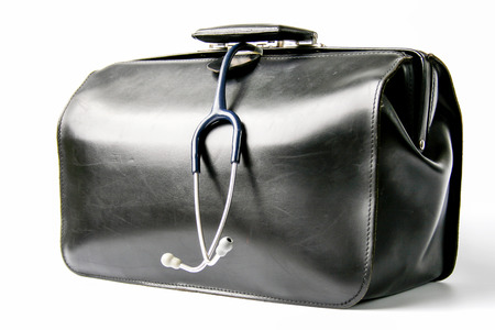 house call: black leather doctors bag with stethoscope hanging out  Stock Photo