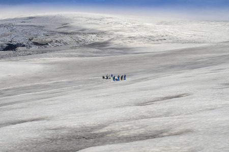 Dog sledding tour on a glacier in iceland photo