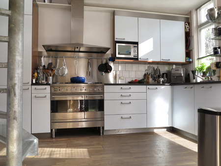 Modern kitchen interior with sunlight on wooden flor