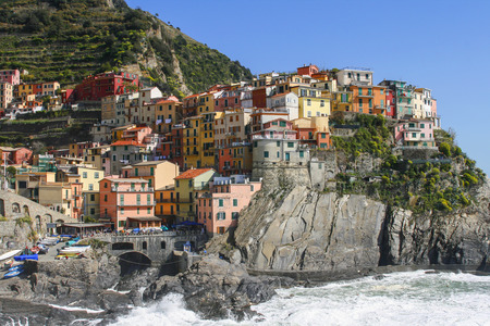 beautiful town of Corniglia in cinqueterre in Italy with many colorful houses perched on a cliff photo