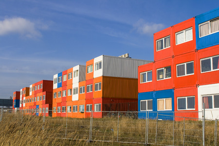 housing problems: multi colored houses in red and orange and blue in Amsterdam