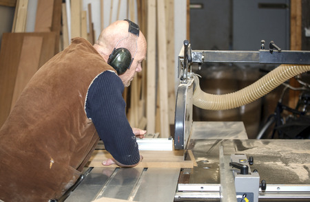 woodworker: Carpenter working with circular saw blade