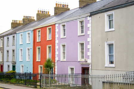 Colorful houses on a row in a Dublin street with a to let sign in front of one of them Stock Photo - 27725025