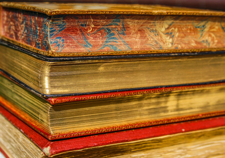 literary: vintage books with special coating of gold on pages Stock Photo