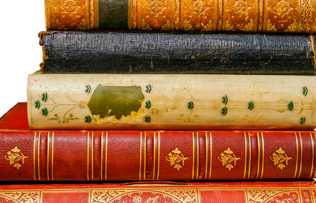 book spine: Five very old antiquarian books stacked on side in leather covers isolated