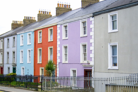 Colorful houses on a row in a Dublin street with a to let sign in front of one of them photo