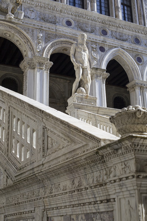 architectural styles: Statue of Neptune on top of the Giants Stairway of the Doges Palace, Venice, Italy