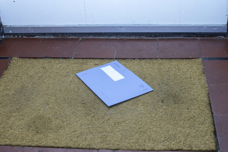 Blue envelope from the Dutch tax office on the door mat Stock Photo