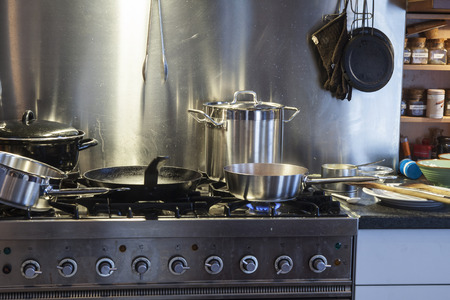 skillet: Messy kitchen and stove during cooking Stock Photo