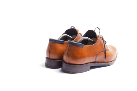 Back side of brown leather mens shoes with shoestrechers  Stock Photo