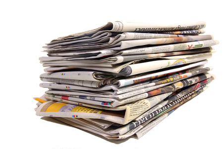 Stack of Dutch newspapers on white