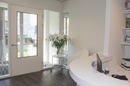 Reception area with waiting room at physiotherapy clinic.