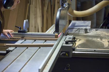 Carpenter working with circular saw blade photo