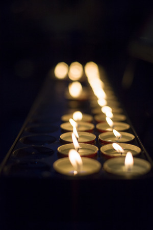 liturgical: Candle lights in dark