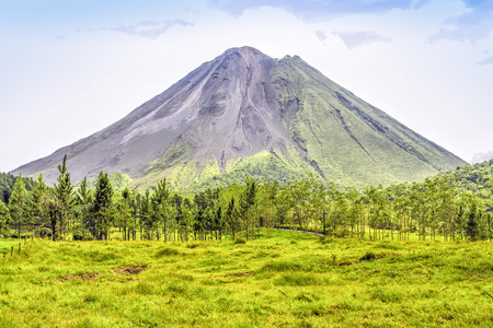 Panoramic view of the lava side and the green side of the famous Arenal Volcano, Costa Rica.