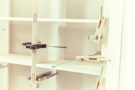 carpenter vise: Bookcase with wood clamps Stock Photo