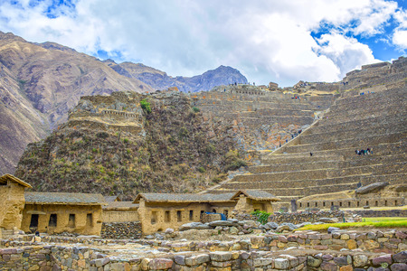 sacred valley of the incas: Incan hillside fortress at the town of Ollantaytambo in the Sacred Valley of the Incas Peru. Stock Photo