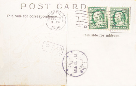 postmarks: Vintage postcard with two one cent stamps and postmarks of 1909