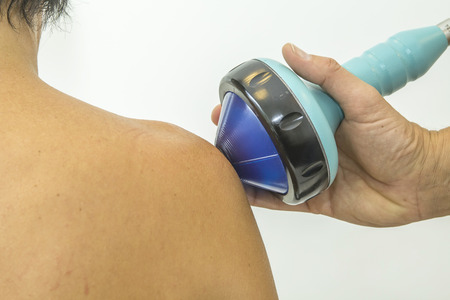 shockwave: Shockwave therapy increases the growth of new blood vessels and is for instance used for treating calcific tendonitis or chronic tendonitis in the foot, elbow, knee or shoulder Stock Photo