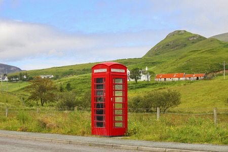 emergency call: Traditional British phone-box in the countryside. Stock Photo