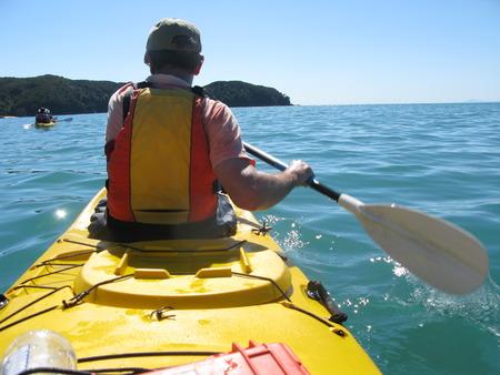 tasman: Man kayaking on the Abel Tasman Bay in New Zealand