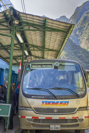 busses: One of the many busses that bring tourists from Agua Calientes to Machu Picchu in Peru   Tourist have two options to reach the peak of Machu Picchu. Either by foot or by bus that takes a zigzagging narrow road to the top.Tourists love the enigmatic Inca c