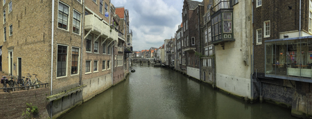 eldest: Canal and historical houses in Dordrecht, Holland. Dordrecht is eldest city in Holland