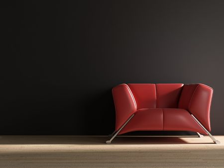red leather armchair to  face a blank wall Standard-Bild