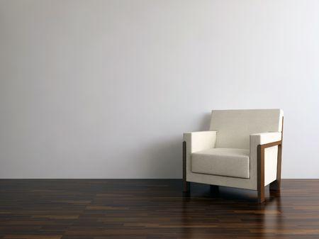 Witte lederen fauteuil geconfronteerd met een lege muur  Stockfoto