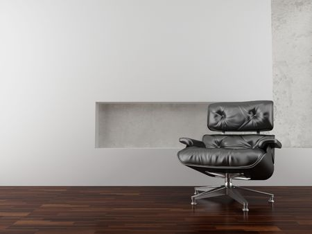 Modern black leather armchair to face a blank white wall