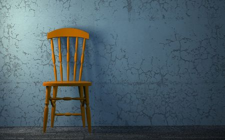Old Wood Chair to face a blank blue wall photo
