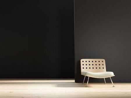 Modern Chair to face a blank black wall Standard-Bild