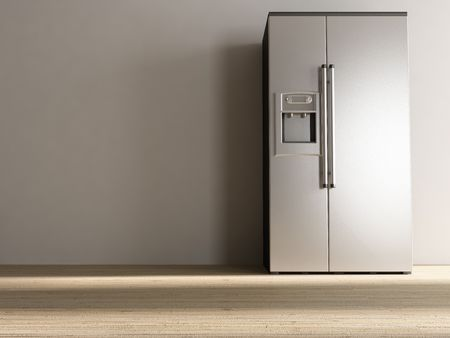 refrigerator: Large Refrigerator to face a blank white wall Stock Photo