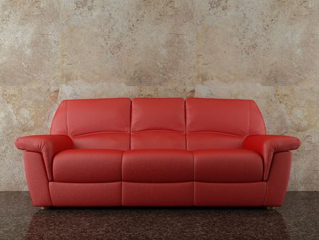 Red leather Couch to face a blank dirty wall photo