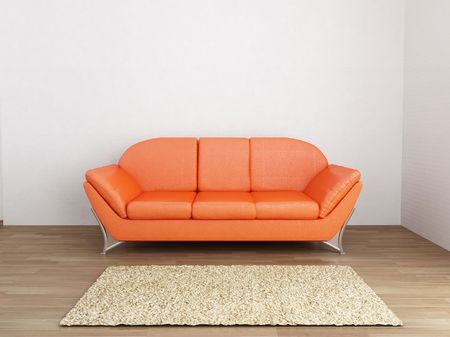 Leather Couch and carpet to face a blank wall Standard-Bild