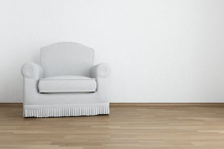 white armchair to face a blank white wall photo